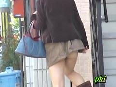 Slender sweetie flashes her booty when some stranger lifts her mini skirt