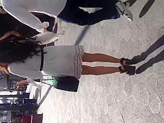 Sexy brunette in see thru white dress