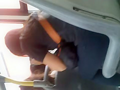 Beautiful brunette with gym pants on the bus
