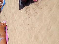 Pink thong on beach