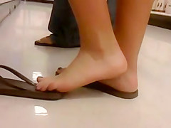 Teen Feet in Flipflops at the Store