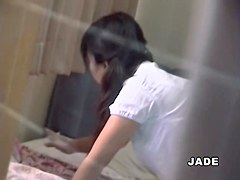 Pissing asian broad gets an orgasm in hot voyeur video