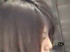 Sexy asian broad masturbates with a fuck toy in voyeur film