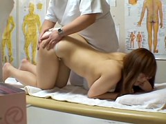 Spy cam massage video of a busty Japanese chick fingered