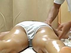 Japanese hottie toyed in oily massage voyeur video
