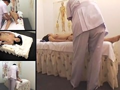 Beautiful Japanese gets fingered in a spy cam massage video