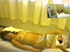Cute Japanese broad fingered in spy cam massage video