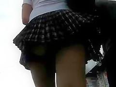 Upskirt - pleated skirt and stockings.
