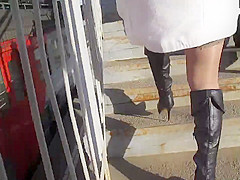 Stockings upskirt on a train station bridge