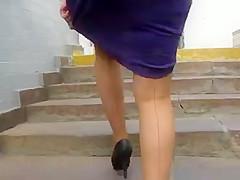 Girl in seameg stockings going upstairs