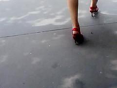 Blond walking in the street, white dress, red heels