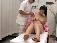 Bulky Japanese enjoys a lot in voyeur erotic massage video