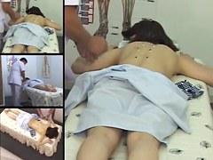 Cute Jap MILF fingered in voyeur massage room video