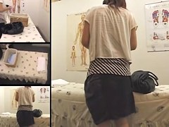Japanese babe with nice tits enjoys a massage on spy cam
