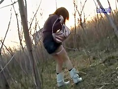 Japanese girl releases a golden shower in the public park