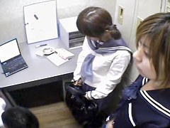 Two Asians blowing on one dong in Japanese sex video