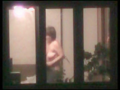 Naked woman in window
