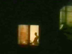 Horny couple caught playing at open window
