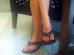 Candid Mature Feet Red Painted Toes in Flip Flops