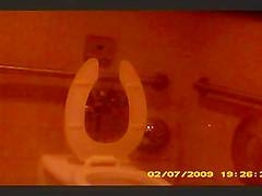 Bathroom spy Short Haired Milf
