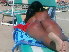 Perfect round latin ass on the beach