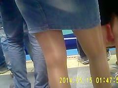 Shiny tan pantyhose girl in metro
