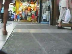Gorgeous babes filmed upskirt by a voyeur guy