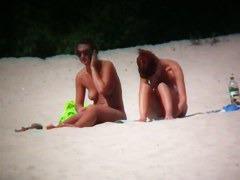 Hot babes filmed on beach by a voyeur