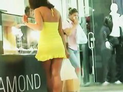 Upskirt clip with babe in sexy high heels and short yellow dress