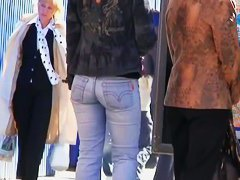 Modest looking blonde woman with cheeky ass in the street candid scene