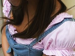 Shy Asian girl answers our questions near the downblouse camera