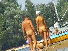 Russian nudist beach with couples sunbathing sweet