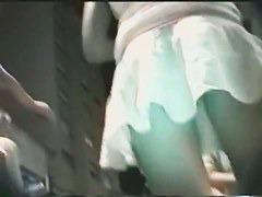 Slutty looking girl in short skirt on the upskirt night footage