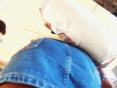 Rear and frontal upskirt voyeur shots of a curvy lady