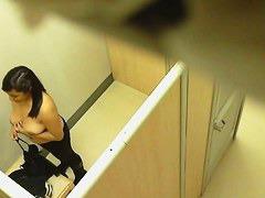Hidden camera in changing room catches a hot teen brunette