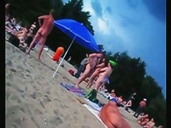 A voracious voyeur loves making videos on the nude beach.