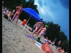 A voracious voyeur loves making videos on the nude beach.