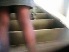 Public upskirt voyeur takes his chance on the escalator.