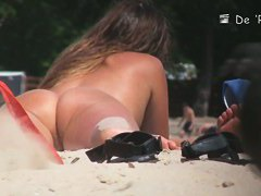 Nude beach voyeur enjoys looking at sexy naked girls.