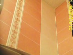 Peeing spy cam catches a mature woman urinating