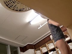 Asian girl in changing room stays out of her cloths pk09