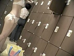 Girls of the oriental origin strip in changing room 436 su0301