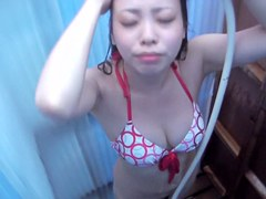 Girl in sexy bikini is showering her body on spy cam shp32