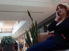 Mature woman sitting on mall bench