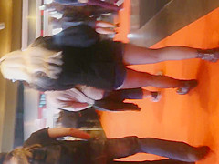blonde with denim short black pantyhose
