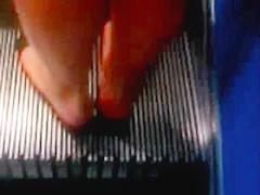 Feet on an escalator - Rolltreppenfuesse