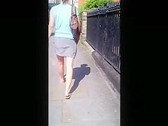 Candid skirt bare legs