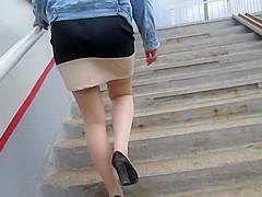 Girl in tan stockings going upstairs
