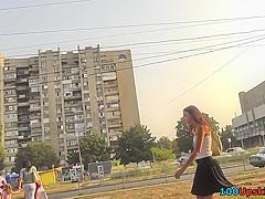 Upskirt caught brunette teen wearing cute thong