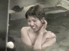 Smiling Asian is in the pool on the voyeur cam video nri104 00